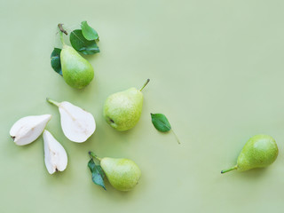 Fototapete - Green pears on a green background, top view, flat lay.