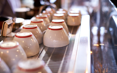 Close Up Of Cups Arranged On Machine In Coffee Shop