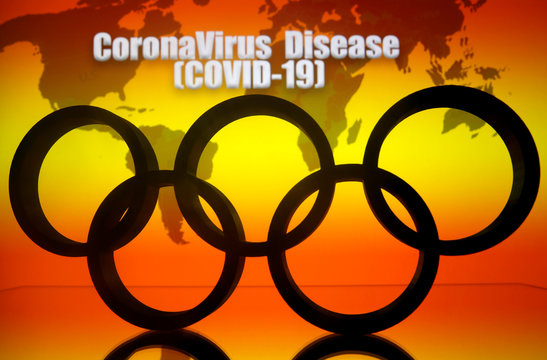 """A 3D printed Olympics logo is seen in front of displayed world map and  """"Coronavirus Disease (COVID-19)"""" words in this illustration"""