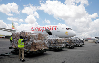 A man takes a picture of a shipment of medical supplies donated to Africa, in Nairobi