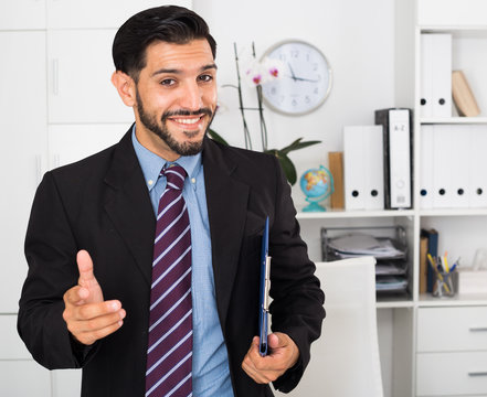 Smiling man is talking about contract