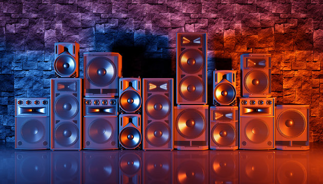 speaker system on a black background in blue and orange lighting