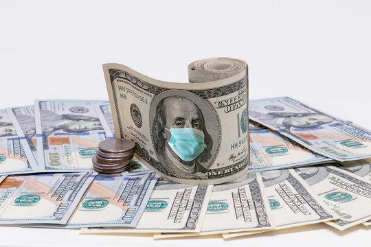 100 dollar money bills with face mask, COVID-19 coronavirus in USA. Coronavirus affects global stock market.