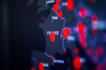 France. Coronavirus COVID-19 global cases Map. Red Dot showing the number of infected. Johns Hopkins University map on monitor display.