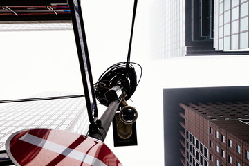 Surveillance camera in the city with high-rise buildings in the background.
