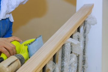 Carpeted in refinishing the stairwell of railing in a Sandpaper sanding Wall mural