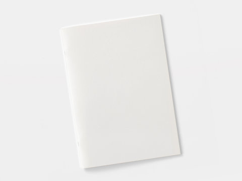 Blank magazine or brochure isolated on white. Front cover top view as mockup template for your design presentation