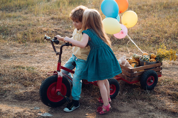 Beautiful fun day for cute friends in nature. Little cute kids are smiling. Children outdoors in nature. Little children have fun on fresh air. Happy brother and sister.