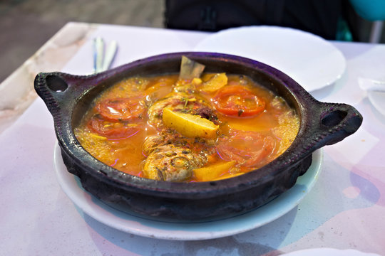 Tajine with stewed vegetables and fish. One of the types of Moroccan national cuisine.