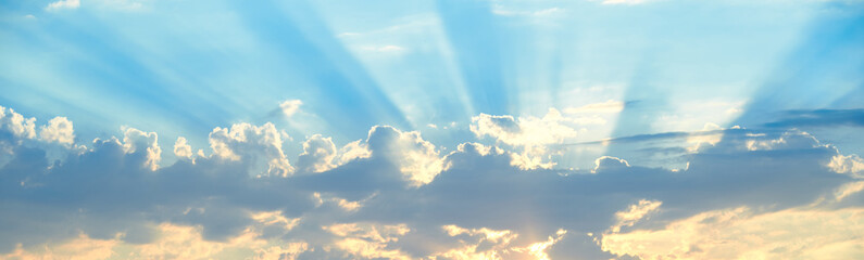 The background of sun rays over clouds. The sun rays break over the clouds. Wall mural