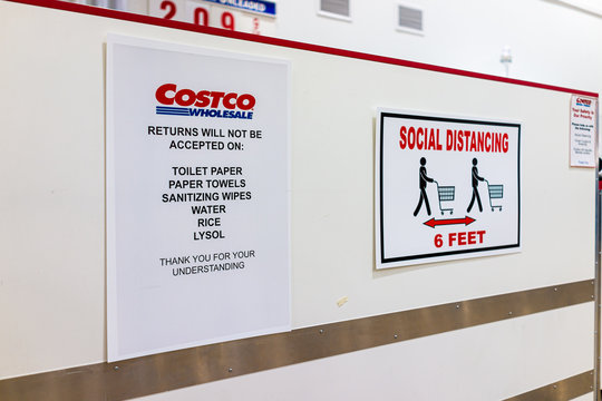 Sterling, USA - March 23, 2020: Sign in Costco discount membership club store during Coronavirus Covid-19 outbreak for social distancing and no returns for toilet paper, paper towels