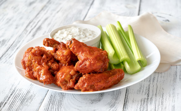 Bowl of buffalo wings with blue cheese dip
