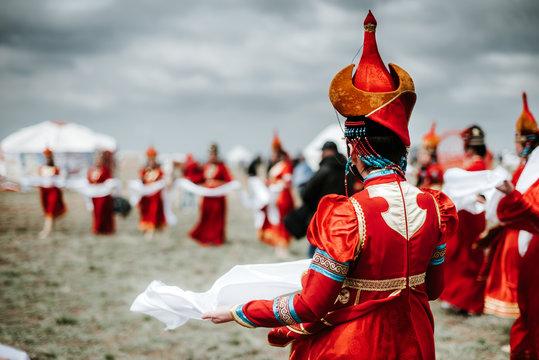 Photo of young beautiful women wearing in traditional national mongolian kalmykian dresses in the festival.