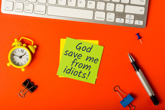 God save me from idiots - message on office workplace