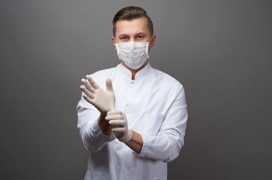 Doctor wearing protective latex gloves and face mask