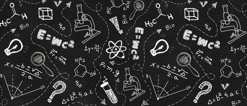 Dark blackboard with white school supplies doodles. Back to school concept.