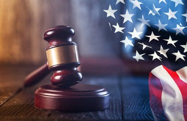 Wooden judge gavel and american flag
