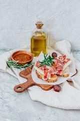 Spanish iberico ham with toasts on wood table