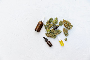 Marijuana oil cbd bottle, Medical Marijuana Cannabis Oil Extract In Bottle On White Background With Copy Space. Selective Focus, Top View