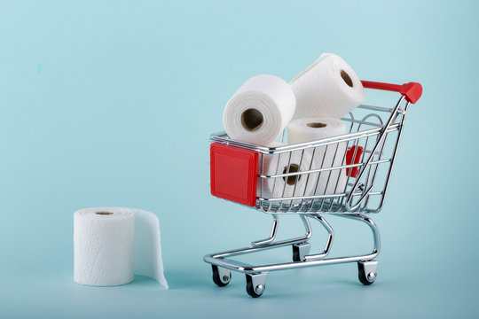 Toilet paper rolls in shopping trolley. Panic about coronavirus covid-19. People are stocking up essentials for home quarantine.