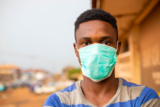 young handsome man african wore face mask preventing, prevent, prevented himself from the outbreak in his society.
