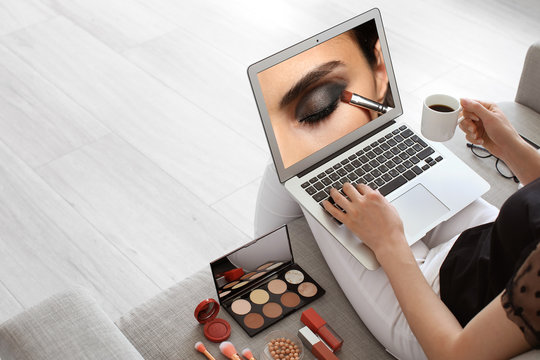 Female makeup artist with laptop at home