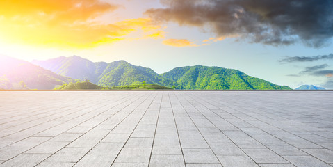 Foto auf Leinwand Gelb Schwefelsäure Empty square floor and green tea mountain nature landscape at sunset,panoramic view.
