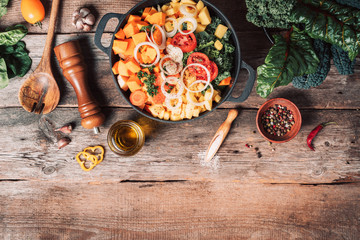 Zelfklevend Fotobehang Eten Ingredients for cooking on wooden table. Vegan diet concept with copyspace. Organic vegetarian ingredients and kitchen tools. Healthy, clean food and eating concept. Zero waste