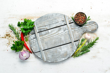 Fotomurales - Cooking background: kitchen board with spices and vegetables. Free space for your text. Rustic style.