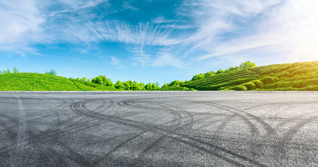 Canvas Prints Pool Race track road and green tea mountain on a sunny day,panoramic view.