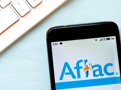 In this photo illustration Aflac Inc. logo is seen displayed on a smartphone