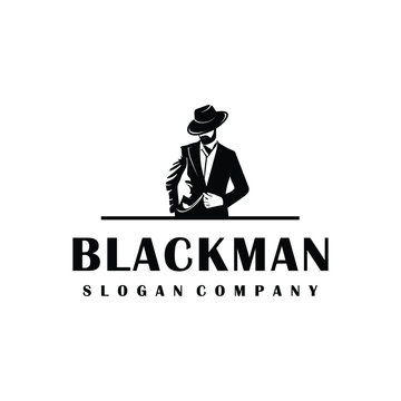 Black man logo design. Awesome man logo. A man with suit and hat logotype.