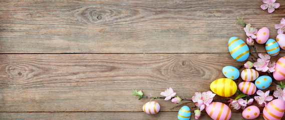 Gift card with colorful easter eggs on old wooden table.