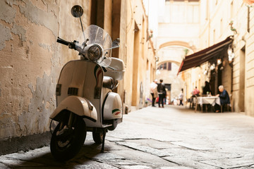 Fototapeten Scooter One of the most popular transport in Italy, vintage Vespa