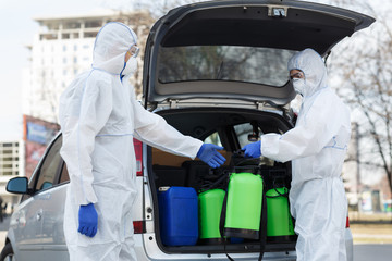 People in protective suits planning to do disinfection with chemicals