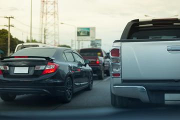 Fotomurales - red tail light brake of stop car on road traffic jam