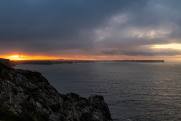 Beautiful scenic view of the Sagres promontory from the Beliche Fort at sunrise, in Algarve, Portugal