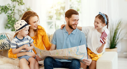 Happy family with map and passports planning travel.