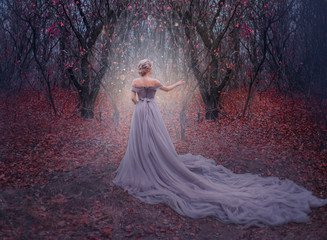 art photo young beauty woman queen. autumn purple mystic tree. fantasy entrance world magic divine glowing in dark deep forest. lady princess in elegant vintage dress, long train back medieval clothes