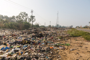 rubbish by side of highway in india