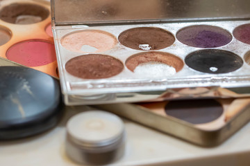 Palette of Multi-colored Cosmetics Eyeshadows and Brushes