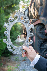 bride and groom concept,  posing with vintage frame