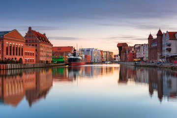 Gdansk with beautiful old town over Motlawa river at sunset, Poland.