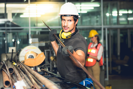 Experienced operator technician Caucasian male, Working by preparing steel, copper pipes Which are raw materials used industrial applications to professional worker manufacturing concept