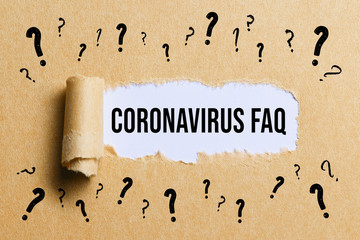 torn paper with many question marks revealing the text CORONAVIRUS-FAQ
