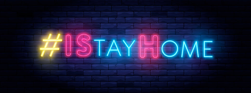 I Stay home hashtag in neon style. Coronavirus pandemic protection and prevention effort. Social activity message. Self-isolation and quarantine. To stay at home brightly illuminated neon sign on wall