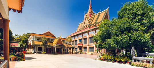 Fotobehang Oude gebouw Wat Preah Prom Rath. Buddhist temple complex with gardens. Siem Reap, Cambodia. Panorama.