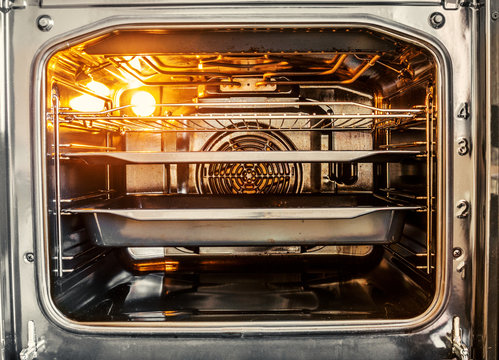 Inside of empty electric stove oven