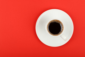 Full white espresso coffee cup over red