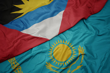 Deurstickers Noord Europa waving colorful flag of kazakhstan and national flag of antigua and barbuda.
